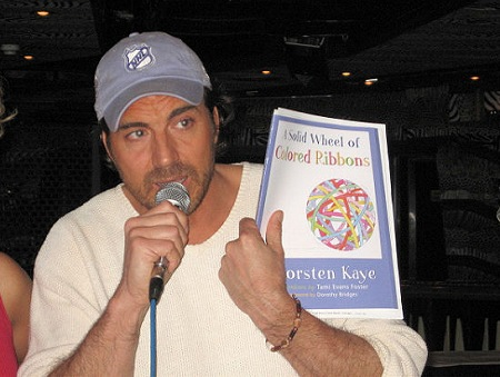 With a copy of his new book, A Solid Wheel of Colored Ribbons