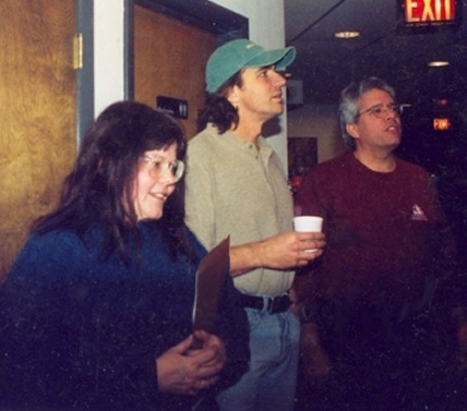 Inspecting the Wall of CD's Recorded at Omega Studios (L-R: Kathy Brand, Thorsten Kaye, Bob Yesbek)